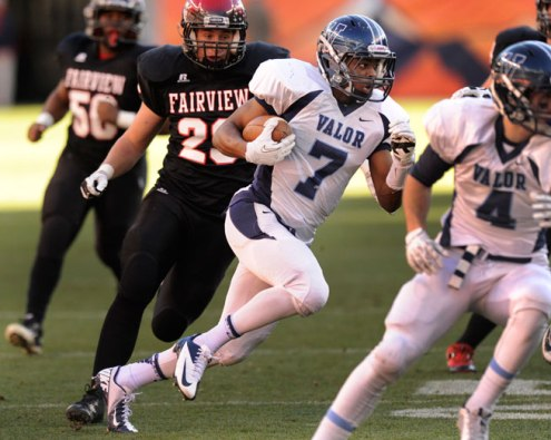 Eagles' wide receiver Eric Lee Jr. made a cut back against the grain on a first quarter reverse that netted the first points of the game. The Valor Christian football team rolled past Fairview 56-16 in the 5A championship game on Nov. 30, 2013. (Karl Gehring, The Denver Post)