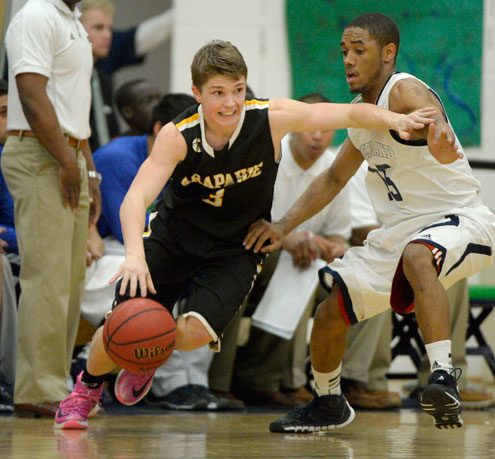 Arapahoe Nick Farmen (3) drives around Overland Austin Conway (15) during their 5A basketball game Feb. 12, 2014 in Aurora. (John Leyba, The Denver Post)  Source: DP