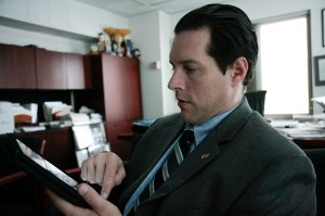 Dean of Student Affairs Peter Konwerski, seen here on his iPad, got The Onion treatment Wednesday. Hatchet File Photo