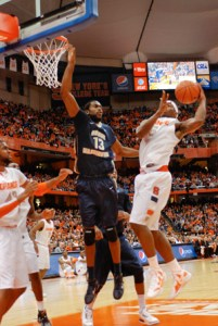 Graduate student forward Jabari Edwards tries to block a Syracuse shot. Elizabeth Traynor | Hatchet Staff Photographer