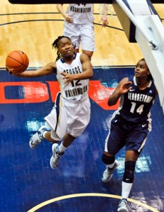 Senior guard Danni Jackson leaps to the net during GW's game against Georgetown last season. GW lost that game 70-54. Hatchet File Photo