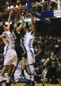 Then-Ffreshman forward Patricio Garino leaps through Rhode Island defenders for a bucket last season. Hatchet File Photo