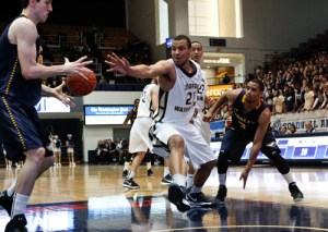 Then-freshman forward Kevin Larsen reaches for the ball during a game against La Salle last season. Hatchet File Photo