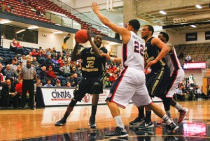 Senior forward Isaiah Armwood goes up against a Duquesne defender in the two team's matchup last season. Hatchet File Photo