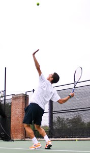 Then-freshman Danil Zelenkov hits a serve during practice. | Hatchet File Photo