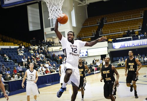 Forward Isaiah Armwood dunked against a Bowie State defense that tested GW with early pressure. Armwood helped lead GW with 16 points and seven blocks. Cameron Lancaster | Contributing Photo Editor