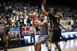 Kevin Larsen goes up in the post against VCU earlier this season. Hatchet File Photo