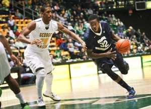 Isaiah Armwood drives past a George Mason defender on Saturday. Armwood was one of five GW players to finish in double figures. Cameron Lancaster | Assistant Photo Editor