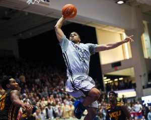 Kethan Savage goes up for a dunk against VCU in GW's upset win last Tuesday. Cameron Lancaster | Assistant Photo Editor