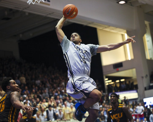 Kethan Savage goes up for a dunk against VCU in a game last season. Hatchet File Photo.