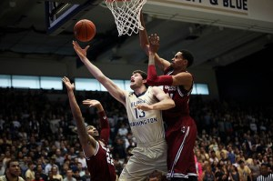 Sophomore forward Patricio Garino slices between two UMass defenders earlier this season. Hatchet File Photo