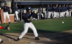 Junior Xavier Parkmond hits an RBI single Thursday against Delaware State to extend GW's lead to 5-3 in the sixth inning. Josh Solomon | Hatchet Staff Photographer