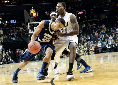 Sophomore Joe McDonald struggles to get around a VCU defender in March. File Photo by Samuel Klein | Photo Editor