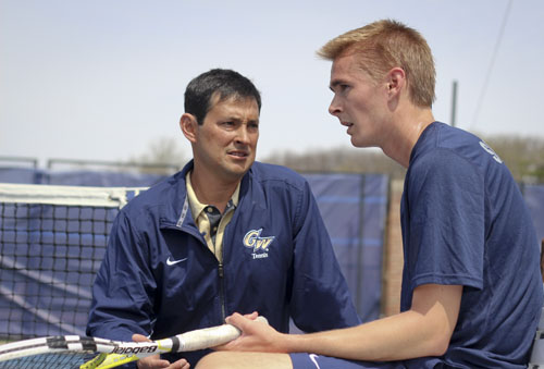 Head coach Greg Munoz talks with senior Viktor Svensson during GW's 5-2 victory over Georgetown earlier this season. Hatchet File Photo