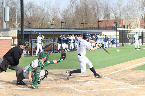 Then-senior Owen Beightol hits in GW's win against George Mason last season. File Photo by Zach Montellaro | Hatchet Staff Photographer