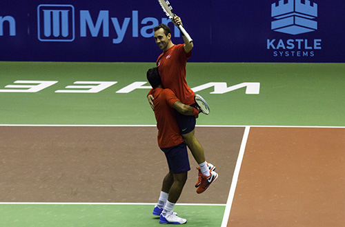 Bobby Reynolds and Leander Paes celebrate after winning the men's doubles set 5-2. Their win clinched the Washington Kastle's win over the Texas Wild. Zach Montellaro | Hatchet Staff Photographer