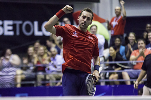 Bobby Reynolds pumps his fist after clinching the men's singles set 5-4. Zach Montellaro | Hatchet Staff Photographer