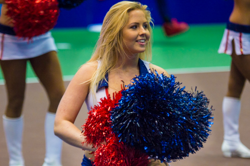 A Kastles cheerleader performs in the pre-match announcements. Zach Montellaro | Hatchet Staff Photographer