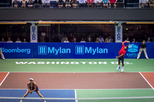 Leander Paes serves the ball over his partner Martina Hingis. They won the mixed doubles set 5-2. Zach Montellaro | Hatchet Staff Photographer