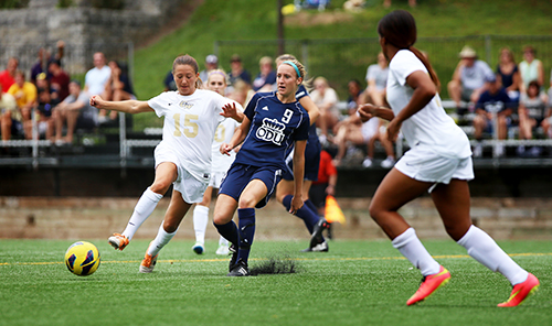 Junior midfielder Nicole Belfonti fights for possession against an Old Dominion player on Aug. 24. Hatchet File Photo