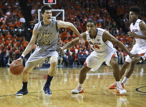 Then-freshman Yuta Watanabe drives toward the paint in GW's game against Virginia last November. The Colonials second game of the home-and-home agreement will be broadcast on ESPN2 as ESPN's first men's college basketball game of the 2015-16 season Monday. Hatchet File Photo.