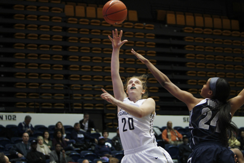 Sophomore Hannah Schaible reaches for the ball in the Colonials' win over Georgetown last week. Schaible scored 12 points and added seven rebounds against Memphis. Andrew Goodman | Hatchet Staff Photographer