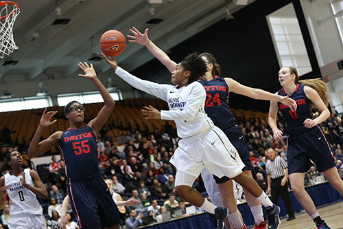 Senior guard Lauren Chase reels in the ball in a game earlier this season. Chase scored 16 points and dished out five assists as the Colonials took control in overtime at Richmond Thursday to win 81-69. Dan Rich | Hatchet Photographer
