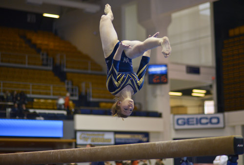 Sophomore Chelsea Raineri executes a difficult sequences towards the end of her balance beam routine.