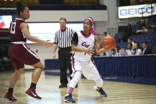 Chakecia Miller looks to pass a ball during GW's win over Fordham. Miller had 10 points and 5 assists during the game. Cameron Lancaster | Photo Editor