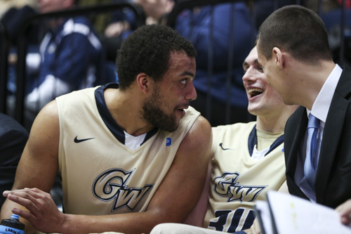 Kevin Larsen, Tyler Cavanaugh and Matt Cimino celebrate during GW's win over Duquesne. Cavanaugh and Larsen combined for 39 points in GW's win at UMass on Tuesday. Dan Rich | Contributing Photo Editor