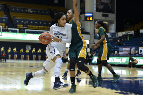 Sophomore guard Brianna Cummings drives in GW's win against George Mason earlier this season. Andrew Goodman | Hatchet Staff Photographer