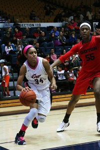 Sophomore guard Bri Cummings drives around a defender in GW's win against Dayton on Sunday. File Photo by Jordan McDonald | Hatchet Staff Photographer