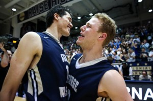 Sophomores Yuta Watanabe and Paul Jorgensen celebrate GW's win over Florida. The pair combined for 40 minutes of play. Dan Rich | Contributing Photo Editor