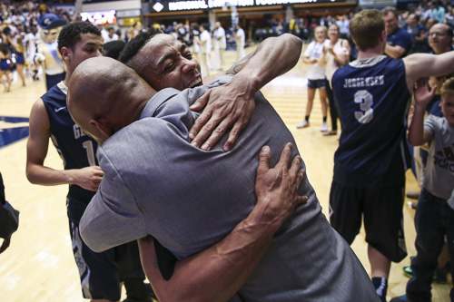 Senior guard Joe McDonald hugs Associate Head Coach Hajj Turner after the Colonials defeated florida. GW will head to Madison Square Garden on Tuesday for the semifinals. Dan Rich | Contributing Photo Editor