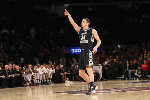 Redshirt junior Tyler Cavanaugh signals to the crowd after draining a three-point basket in GW's win against SDSU. Cavanaugh led the Colonials with 20 points and 11 rebounds. Dan Rich | Contributing Photo Editor