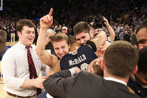 Senior Joe McDonald hugs his teammates after winning the NIT championship. Dan Rich | Contributing Photo Editor
