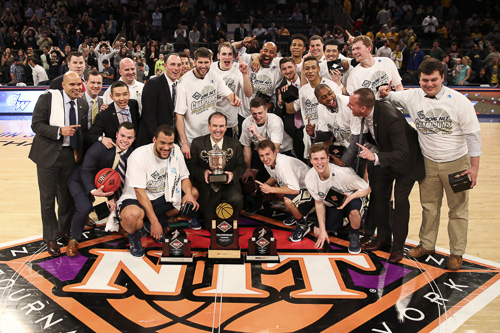 The team poses with the NIT championship trophy, the first in program history. Dan Rich | Contributing Photo Editor