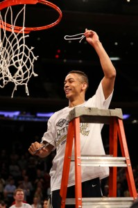 Senior guard Joe McDonald cuts down the nets in Madison Square Garden. Dan Rich | Contributing Photo Editor