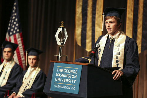 Dan Henry, a senior and captain of the rowing team, speaks at athletics commencement. Dan Rich | Photo Editor