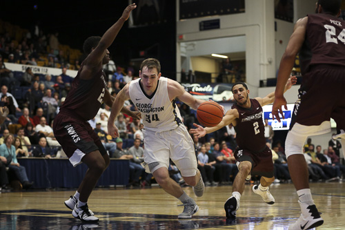 Graduate student forward Tyler Cavanaugh scored 24 points and added 10 rebounds in GW's season-opening victory over UMES Friday.