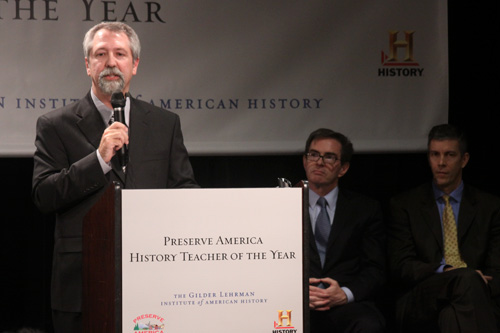 Teacher Timothy Bailey speaks after being awarded the National History Teacher of the Year award at The School Without Walls Tuesday. U.S. Secretary of Education Arne Duncan, right, was on hand to congratulate him.