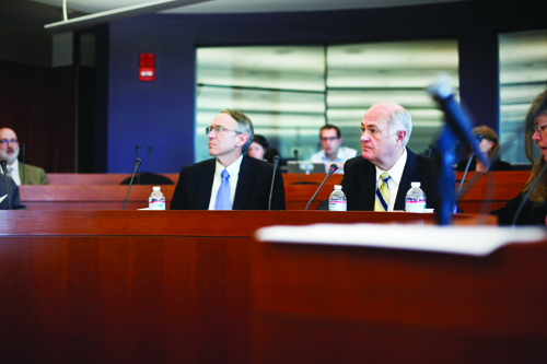 University President Steven Knapp, right, took over in GW in 2007 just as its price tag crossed the $50,000 threshold. Hatchet File Photo