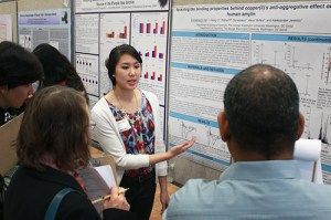 Senior Emmeline Ha presents a poster at research days in the Marvin Center this week. Nicole Radivilov | Hatchet Staff Photographer