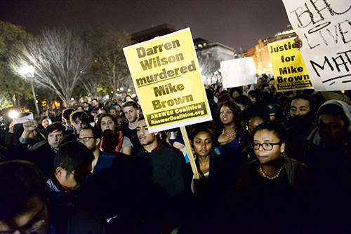 Students from Howard, American and Georgetown Universities poured in front of the White House in protest of a grand jury decision to not bring charges against police officer Darren Wilson for the shooting of Michael Brown in Ferguson, Mo. this past August. Samuel Klein   Senior Photo Editor