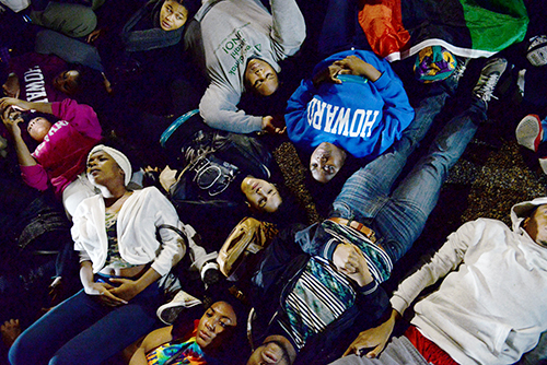 Students from American, Howard, Georgetown and George Washington Universities lay on the ground in front of the White House in protest of a grand jury decision not to press charges against officer Darren Wilson in the shooting of Michael Brown. Samuel Klein | Senior Photo Editor