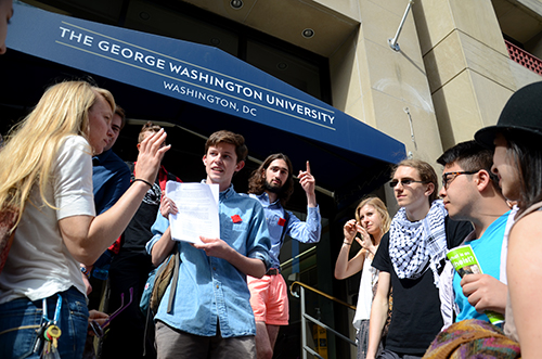 Members of the GWU Progressive Student Union gather outside Rice Hall to deliver a petition to President Steven Knapp demanding affordable and sustainable dining options for students. Katie Causey | Hatchet Staff Photographer