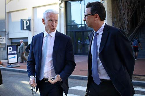 CNN anchor Anderson Cooper speaks to School of Media and Public Affairs Director Frank Sesno outside Lisner Auditorium Monday. Desiree Halpern | Photo Editor