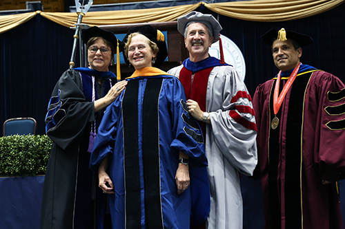 Former Provost Steven Lerman, center, hooded his wife, Lori J. Lerman, at the doctoral hooding ceremony Thursday. Interim Provost Forrest Maltzman, right, delivered remarks at the event. Olivia Anderson   Contributing Photo Editor