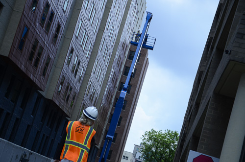 Responders from D.C. Fire and EMS are in the process of rescuing two GW construction workers stuck on a hydraulic lift near District House Friday. Dan Rich | Photo Editor