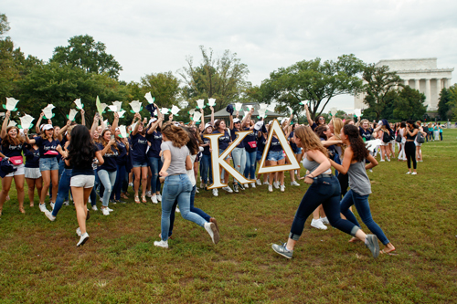 Members of Kappa Delta run after receiving their bids. Kevin Chen | Hatchet Photographer